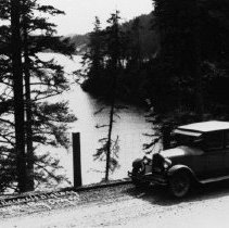 Image of N8760 - REMARKS:Early touring car ca. 1930s, near Clear Lake south of Winchester Bay on the old Roosevelt Highway (No. 101). Road was unpaved at the time.  OBJECT DATE:ca. 1930s