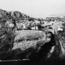 Image of N8799 - REMARKS:Roseburg, Or. from the south ca. 1924. View shows old Highway, Southern Pacific track, Alexander bridge, etc.  OBJECT DATE:ca. 1924