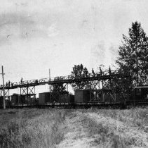 Image of N8823 - REMARKS:Southern Pacific electric motor No. 102 with work train and coach putting up overhead catenary between Portland and Eugene. ca. 1915.  OBJECT DATE:ca. 1915