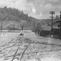Image of N8886 - REMARKS:Oakland, Or. looking south down First Street, ca. 1915. View shows snow on ground, horsedrawn rig in distance.