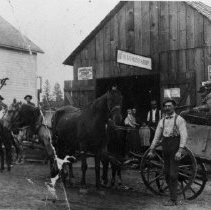 Image of N9013 - REMARKS:Fred Schneider's Blacksmith Shop at Camas Valley, OR, ca. 1900. The Trowbridge Store is at the left.