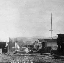 Image of N9207 - REMARKS:Yoncalla, Oregon, ca. 1909. The view looks East on Main Street. Wooden false fronted brick buildings lined the street looking toward the railroad yards.  OBJECT DATE:ca. 1909