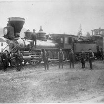 Image of N926 - REMARKS:Oregon and California Railroad locomotive and caboose at Glendale, Or. ca. 1884. Hotel in rear.