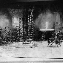 Image of N9303 - COUNT:2  REMARKS:An interior view of the deer antler furniture from the William Dysinger home, Roseburg, Oregon, ca. 1915. The view shows a table, about five chairs, a foot stool and a hall tree, all made of deer antlers; a leopard skin rug is on the floor. The view may have been taken in a studio rather than in the Dysinger home.  OBJECT DATE:ca. 1915