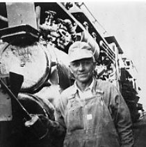 Image of N9980 - REMARKS:Engineer J.A. Eifert standing in front of locomotive.