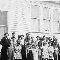 Image of N7127 - REMARKS:District 75, Smick School; teacher and pupils; ca. 1920s.