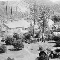 Image of N7245 - REMARKS:A view of an unidentified Northern California mine. The view shows houses with odd fireplaces in the foreground, wash hanging out on a line, etc. Unknown location, ca. 1890s.  OBJECT DATE:ca. 1890s