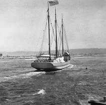 Image of N5983 - REMARKS:Three-masted schooner (RUBY) with steam tug (TRIUMPH), crossing in over Coquille River bar. Lighthouse and quarters on north shore at left of photo.
