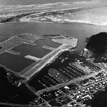 Image of N8191 - REMARKS:Aerial view showing Winchester Bay and Salmon Harbor expansion, April 9, 1971.  OBJECT DATE:April 9, 1971