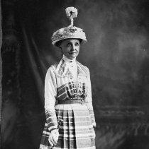 Image of N6038 - REMARKS:Lillie Moore wearing a long dress, umbrella, and an extremely odd hat. ca. 1900.  OBJECT DATE:ca. 1900