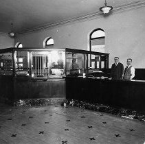 Image of N6061 - REMARKS:Interior, Young and Company Bank, Oakland, Oregon. Pictured: Ed Young (left) and Tom Garrison (right).