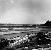 Image of N9137 - REMARKS:Umpqua River mouth and Winchester Bay looking upstrea; the old U.S. Life Saving Station is in the distance.