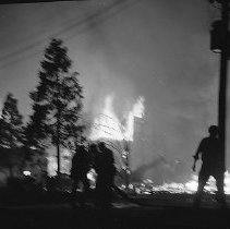 Image of N15342 - REMARKS:Firemen silhouetted against trees and smoke billowing from Blast blaze. Roseburg, OR. August 7, 1959