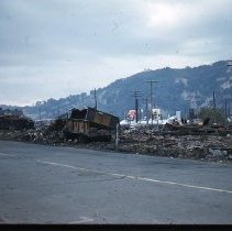 Image of S659 - REMARKS:Destruction after the Roseburg Blast. View shows railroad yards.  OBJECT DATE:August 1959