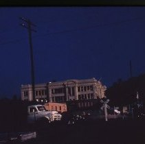 Image of S680 - REMARKS:Aftermath of the Roseburg Blast, August 1959. View is of Central Junior High School with trucks in the foreground.  OBJECT DATE:August 1959