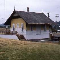 Image of S165 - REMARKS:Dillard RR station partially painted during the restoration at the Douglas County Museum, 1986.