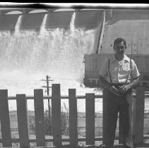 Image of N17545 - Weston Dailey by a dam at unknown location From the Weston Dailey Collection