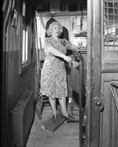 Image of [Woman at fare collection booth at Myrtle Avenue el]