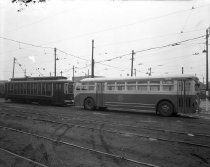 Image of Trolley car #4187 and Bus #1610
