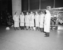 "Image of Men in lab coats at the ""Maintenance of Way"" display at 370 Jay Street, Dec"