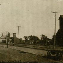 Image of View of Larned railroad tracks and mills.