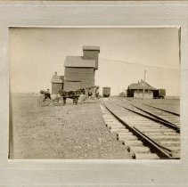 Image of Grain Elevator Near Railroad Tracks