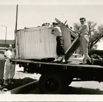 Image of Unloading Outhouse