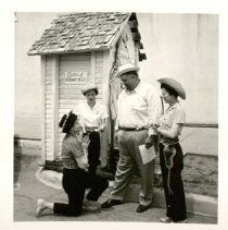 Image of Possible Arrest in Front of Outhouse -
