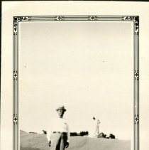 Image of A. A. Doerr Showing a Section of Largest of Three Piles of Wheat - July 12, 1931