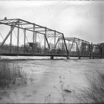 Image of 138. Buggy On Larned West Side Bridge Over The Arkansas River