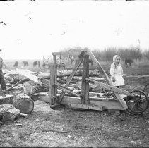 Image of 141. Harry & Ethyl Hartman With Power Saw