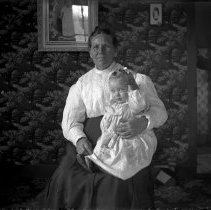 Image of 019. Kate Hartman's Aunt Belle Torrens Boyd & Ethyl H,  Pictures On Wall Of