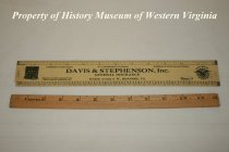 "Image of Wooden ruler with advertisement. - Wooden ruler with advertisement. Printed in the center of the ruler is ""DAVIS & STEPHENSON, Inc., GENERAL INSURANCE, 112 Kirk Avenue, S.W., ROANOKE, VA."" Printed above this is: ""LAWRENCE S. DAVIS, President, W. C. STEPHENSON, Vice President, MARSHALL H. DAVIS, Secretary-Treasurer"". On one end of the ruler is a drawing of a building and to the right of this is printed: ""BONDS OF EVERY DESCRIPTION, EXECUTED ON APPLICATION"". On the other end of the ruler is a compass-like symbol with an American Bald Eagle on top of the American flag. Written above the symbol is: ""WE WILL BOND YOU"" ; the following words appear within the round compass symbol: ""FIDELITY, JUDICIAL, CASUALTY, CONTRACT"". To the left of this symbol is printed: ""PHONE 11""."