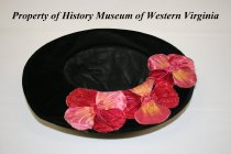Image of Black velvet hat with silk flowers.