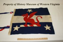Image of Red dragon pennant on blue and white background.
