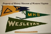 Image of Delta Sigma, MHS (Marshall High School) and Wesleyan pennants.