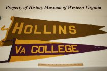 "Image of Various pennants, including college, university and school, as well as fraternity. - Various pennants, including college, university and school, as well as fraternity. 20th century, American. Printed on the pennants are the following: ""HOLLINS,"" yellow lettering on brown background; ""VA COLLEGE,"" gold lettering on purple background; ""DE PAUW,"" black lettering on yellow background; ""ALOHA,"" yellow lettering on purple background along with a drawing of a volcano. There is a red dragon on a blue and white background with three white stars; the symbols for Delta Sigma with gold and blue lettering on a gold and blue background; ""MHS"" (Marshall High School), yellow lettering on green background; ""WESLEYAN,"" white lettering on green background; ""EISNS"" (Eastern Illinois State Normal School), white lettering on red background; ""Illinois,"" orange lettering on navy background."