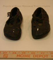 Image of Baby's Leather Shoes - Pair of dark brown leather shoes with steel buckles, for baby. Early 20th century.