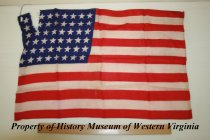 Image of American Flag from 1932 - Small silk American flag from 1932. The flag was given to the donor as a child when President Franklin D. Roosevelt came to Salem, Virginia, to dedicate the Veterans Administration Hospital. The flag has 48 stars.