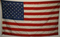 Image of 50-star U.S. Flag from Hotel Roanoke - This United States flag flew over the Hotel Roanoke. It is a modern flag with fifty stars, therefore it is from 1960 or later. It is made of nylon.