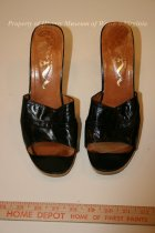 Image of Black Patent-Leather Shoes - Pair of black, patent-leather, high-heel shoes with wood soles and wood high heels. The shoes are open-toe and open-heel. 20th century, American.