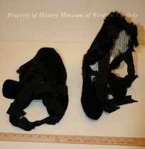 Image of Black velvet boots. - Pair of black velvet and faux fur boots with silk ribbons. 20th century American.