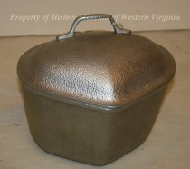 "Image of ""Silver Seal"" Cookware, Vegetable Pot - Hammered aluminum vegetable stewing pot with lid. Back attachment for mounting. There is an area for a detachable handle to attach to the lid. Part of the ""Econ Trio"". 1930's American. ""Silver Seal"" cookware."