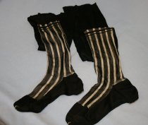 Image of Black Silk Stockings - Black silk stockings with black and white stripes.
