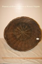 Image of Woven Wood Laundry Basket - Heavy woven wood basket probably used for laundry. 20th century, American. The basket has two handles.