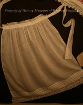 Image of Adult's Apron   - Adult's apron.  Thin, sheer, white fabric with a decorative ruffle on the top, band of lace on the bottom.