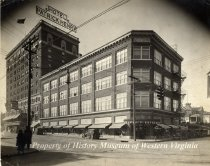 Image of Coulter Building and Hotel Patrick Henry - A black and white photograph of the Coulter Building and the Hotel Patrick Henry, located at the corner of South Jefferson Street and Franklin Road. The photograph was taken in the 1930s.