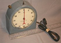 Image of Kodak Electric Timer - A free standing timer with a clock face and a minute and second hand. A cord with a plug is attached to the body. (has been painted)