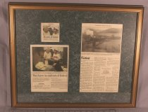 Image of Framed newspaper clippings from The Roanoke Times on photographs Tommy Firebaugh, Festival in the Park. Includes Firebaugh's photograph of the N&W class A #1218 steam engine crossing the James River in Glasgow, Virginia, in 1987.