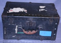 Image of Chest - black/metal chest - handle, metal, clasps on corners handle. Labled O. Winston Link. Peeling mail stickes on outside. Inside: Many cables and a lamp and equipment.